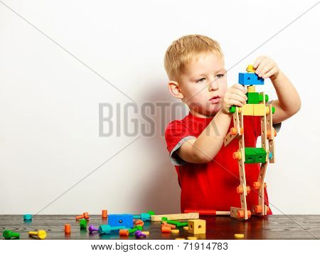 Little Boy Child Playing With Building Blocks Toys Interior.