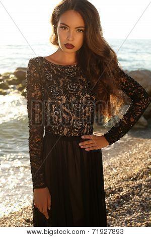 Beautiful Brunette In Black Lace Dress Posing On Beach
