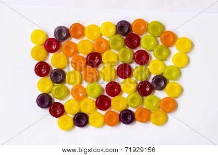 A close-up of varied colour sugar confectionery toffees