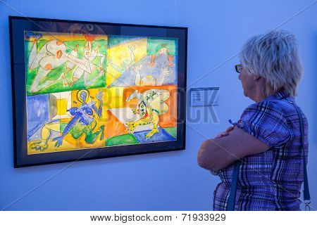 Woman looking at the picture