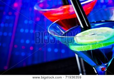 Top Of View Of Cocktail With Blue Light Disco Background With Space For Text