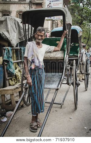 CALCUTTA - MARCH 13, 2013: rickshaw driver working on March 13, 2013 in Calcutta, India. Rickshaws have been around for more than a century, but they could soon be a thing of the past.