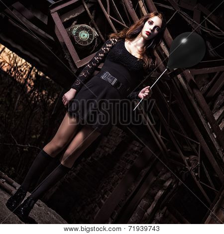 Weird Young Girl Holding Black Balloon