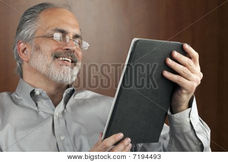 Businessman Reading From A Tablet