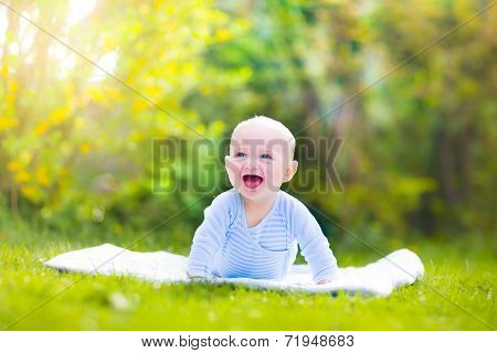 Cute Laughing Baby In The Garden