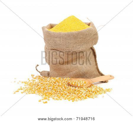 Bag of ground corn and a wooden spoon.