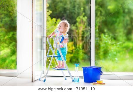 Sweet Little Girl Washing A Window