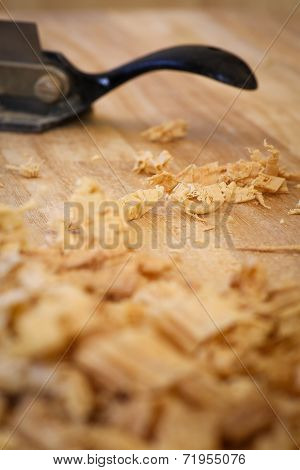 Chip Shavings with Spokeshave of Sapele Hardwood Board