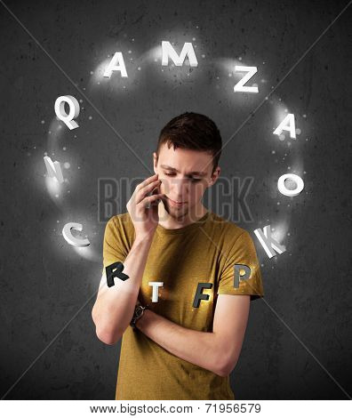 Thoughtful young man with shining letters circulating around his head