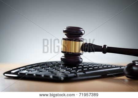 Gavel on computer keyboard concept for online internet auction or legal assistance