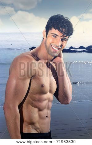 Young good looking male model with great body smiling and having fun outdoors