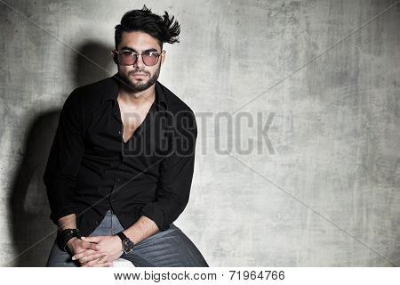Sexy Fashion Man Model Dressed Casual Posing Dramatic Against Grunge Wall