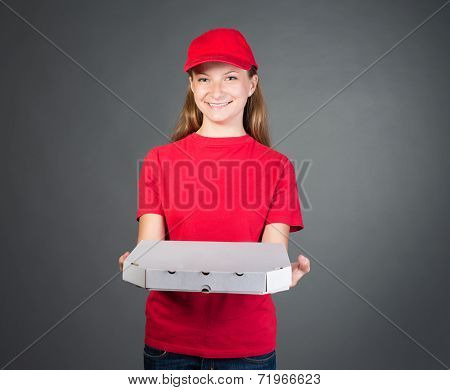 Pizza girl in red uniform delivering pizza isolated on grey background with copy space. Woman food d