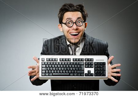 Comouter geek with computer keyboard