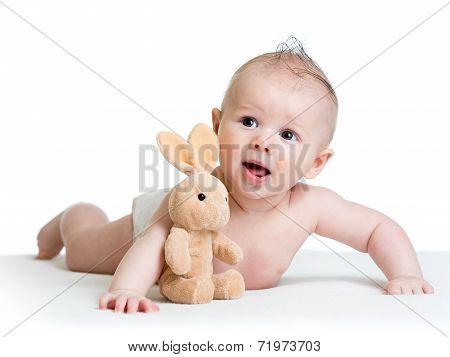 Baby Boy Lying On Tummy With Bunny Toy