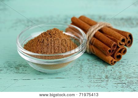 Cinnamon bark and cinnamon powder on wooden table