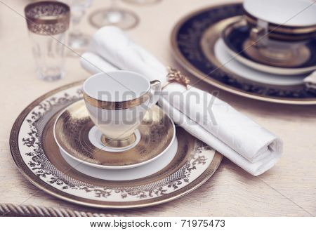 Set of fine bone porcelain dishware, toned image