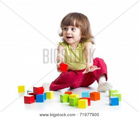Smiling Kid Girl Playing Cubes Toys