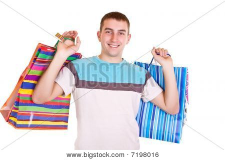Smiling Man Holding Shopping Bags