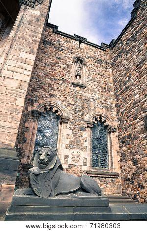 Wide viewof stone lion in Edinburgh castle, closeup