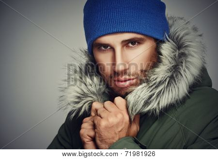 Brutal Face  A Man With Beard Bristles And Hooded Winter