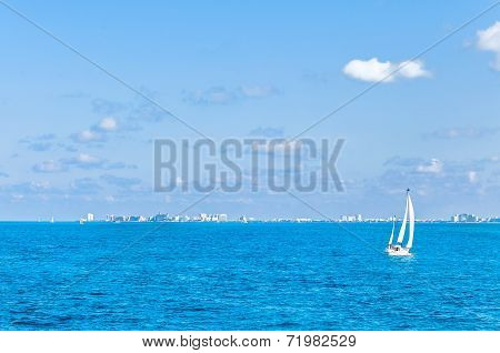 tropical sea, boat and Cancun skyline - Mexico