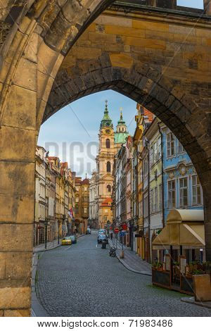 view on the old street and St Nicolas in the Mala Strana.Prague