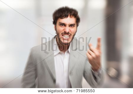 Angry man pointing his finger to you