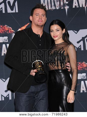 LOS ANGELES - APR 13:  Channing Tatum & Jenna Dewan-Tatum in the 2014 MTV Movie Awards - Press Room  on April 13, 2014 in Los Angeles, CA.