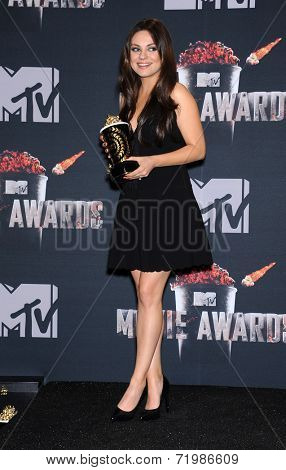 LOS ANGELES - APR 13:  Mila Kunis in the 2014 MTV Movie Awards - Press Room  on April 13, 2014 in Los Angeles, CA.