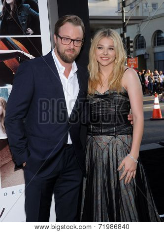 LOS ANGELES - AUG 20:  Joshua Leonard & Chloe Grace Moretz arrives to the 'If I Stay' Hollywood Premiere  on August 20, 2014 in Hollywood, CA