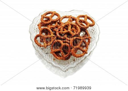 Pretzels In A Heart Shaped Glass Bowl