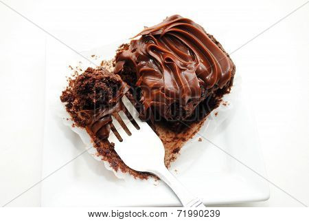 Eating A Chocolate Brownie With A Fork