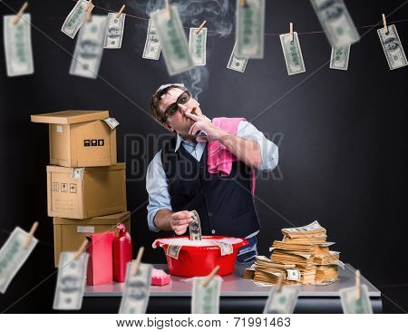 Businessman is laundering money in the basement