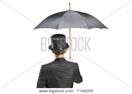 Young man with gloves holding an umbrella