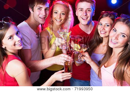 Happy people clinking glasses with each other