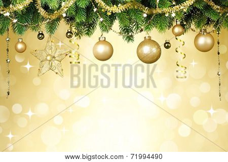 Christmas balls hanging on fir tree over festive background.