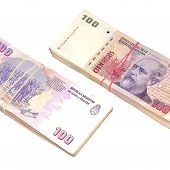 pic of pesos  - Two stacks of one hundred argentinean pesos banknotes isolated on white background - JPG