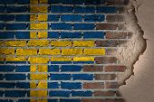 pic of sweden flag  - Dark brick wall texture with plaster  - JPG