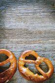 image of pretzels  - pretzels on a dark wood background - JPG