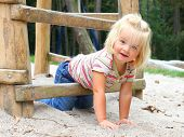picture of playground school  - Little girl playing on a playground - JPG