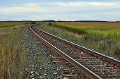 picture of forlorn  - Railroad tracks on a lonely prairie landscape.