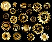 picture of outdated  - Set of gold and brass gears on a black background - JPG