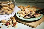 pic of nutcracker  - Peanuts and nutcracker on plate - JPG
