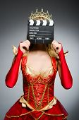 pic of superwoman  - Queen in red dress with movie clapboard - JPG