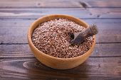 picture of flax seed oil  - Flax seeds in bowl on wooden background - JPG