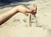 picture of finger  - Sand is pouring through girl - JPG