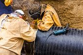 stock photo of pipe-welding  - Welders are welding the pipeline together teamwork - JPG