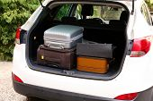 pic of heavy bag  - Suitcases and bags in trunk of car ready to depart for holidays - JPG