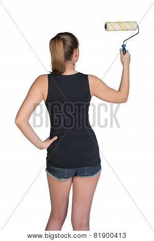 Woman using paint roller
